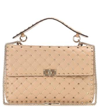 https://www.mytheresa.com/de-de/000276-valentino-garavani-rockstud-spike-chain-leather-shoulder-bag-789362.html?catref=category